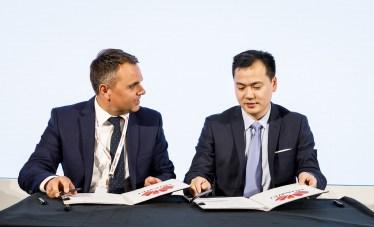 Paul Garston signing Huawei Memorandum